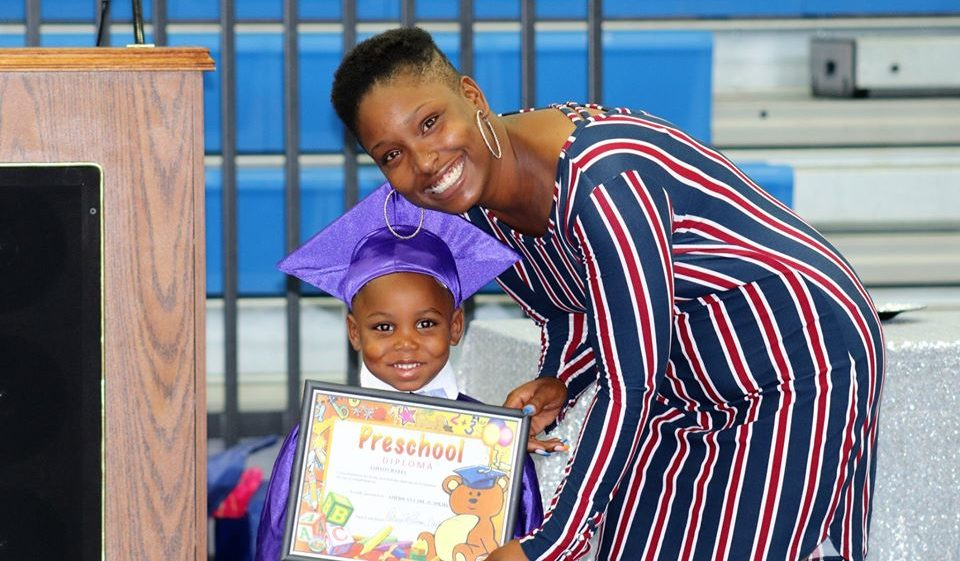 smiling boy graduating at a Preschool & Daycare Serving Dallas, TX