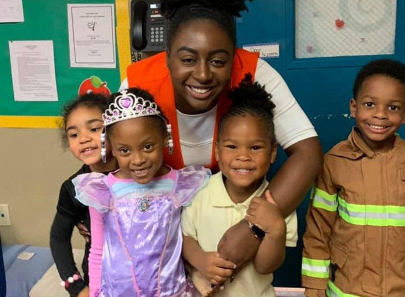 smiling teacher with children at a Preschool & Daycare Serving Dallas, TX